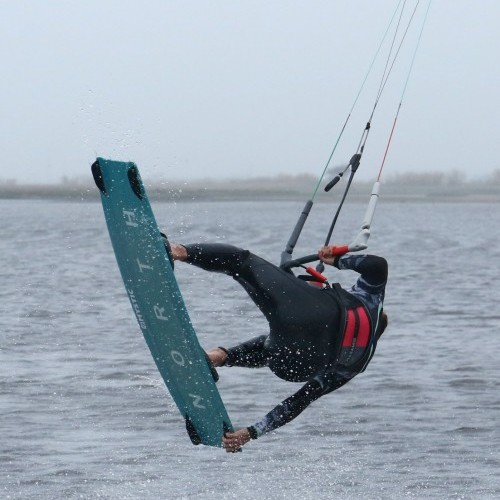 Pop Back Roll to Toeside with Front Hand Grab Kitesurfing Technique