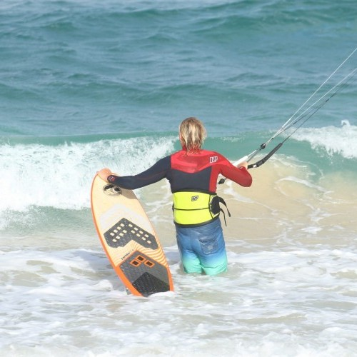 Body Dragging Past the Shorebreak on a Surfboard Kitesurfing Technique